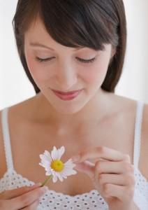 Woman plucking daisy